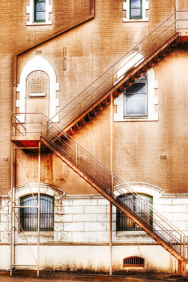 Stairs, exterior fire escape on a historic building.