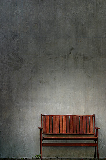 Bench and concrete wall