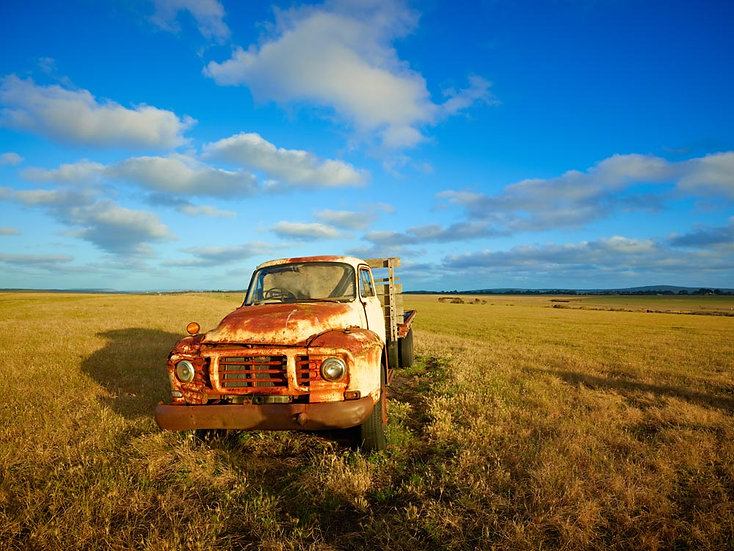Old abandoned vehicle, utility van, farm vehicle, wreck in a paddock.