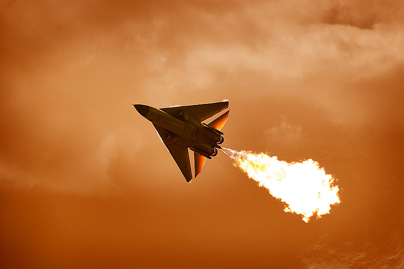 F-111, flying at sunset.