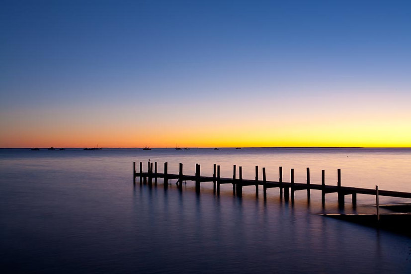 Jetty and boats at dusk, Shark Bay, North Western Australia