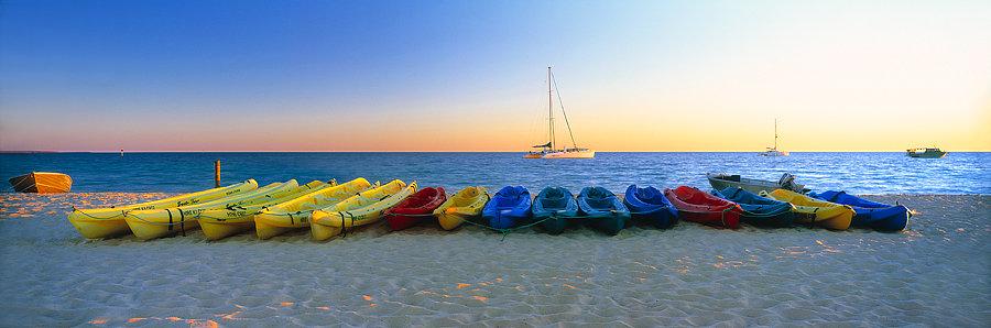 Canoes, kayaks and boats on Monkey Mia beach, North Western Australia