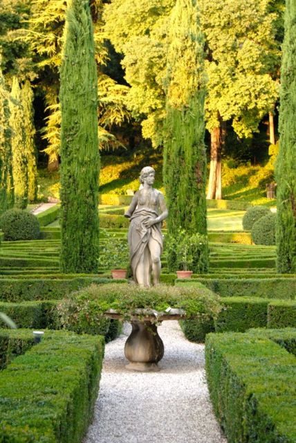 Statue and topiary in an italian garden