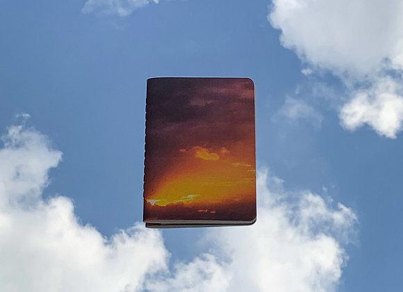 raios de sol entre as nuvens | caderninho