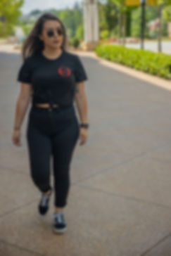 Photo of a model walking wearing a clothing brand for a photoshoot.
