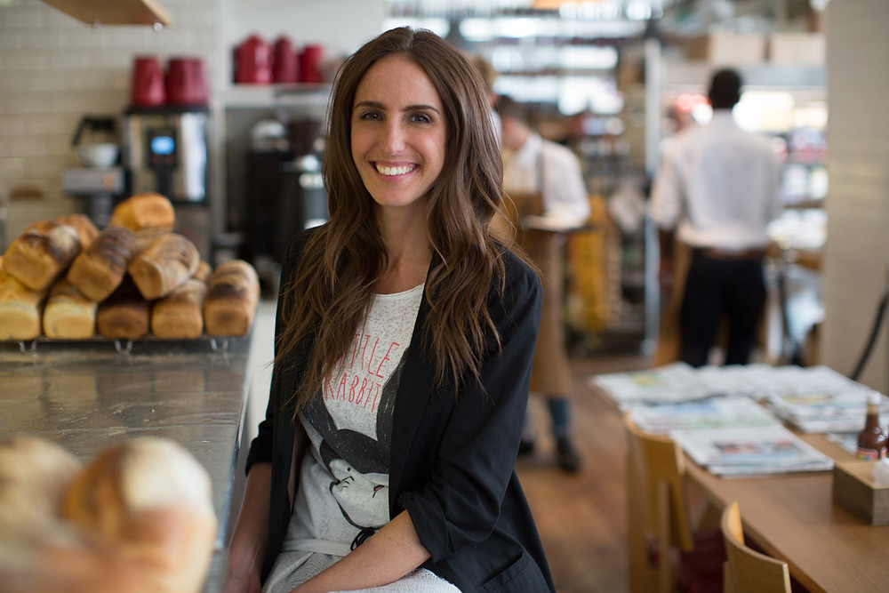 Mel Noakes Self Care Coach smiling in a cafe