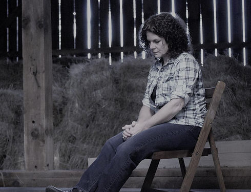 Julie in barn on chair.jpg