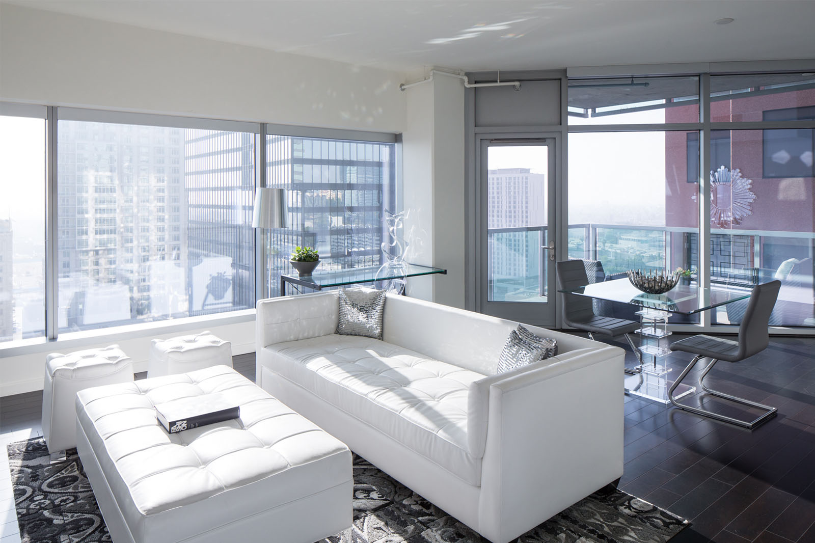 Watermarke Tower Apartments living space lounge with patio and view of Downtown Los Angeles