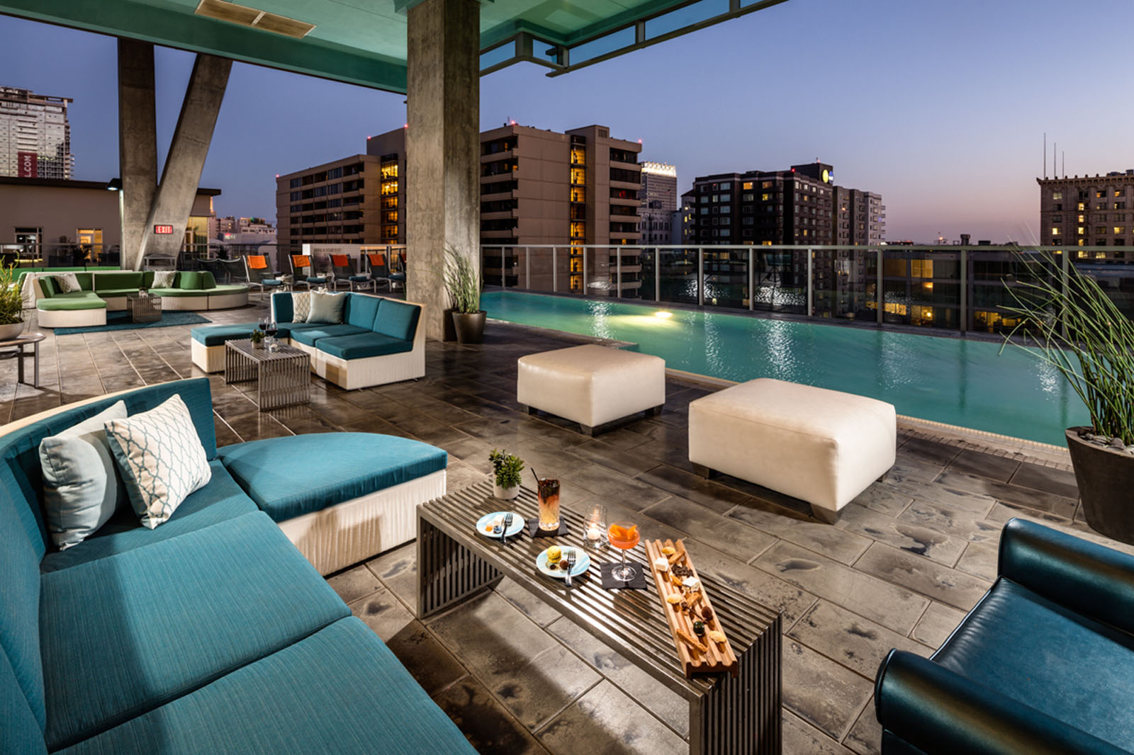 Watermarke Tower Apartments outdoor infinity pool with lounge and views of Downtown Los Angeles