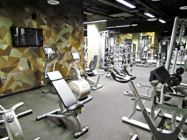 Watermarke Tower fitness center with treadmills and weights