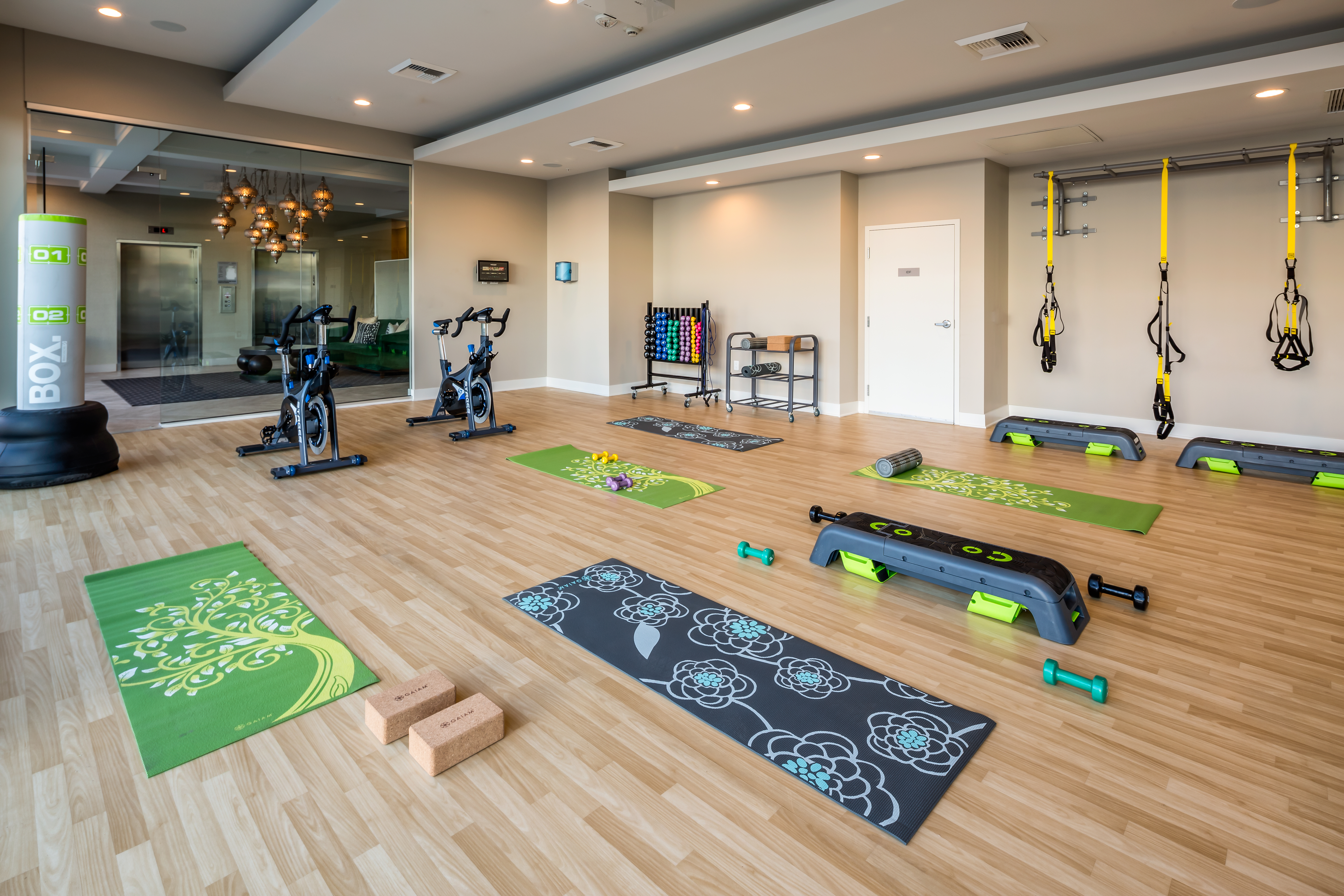 Onyx Apartments yoga studio with yoga mats and bicycles