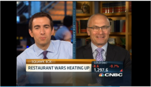 CNBC's Andrew Ross Sorkin and Andy Puzder.