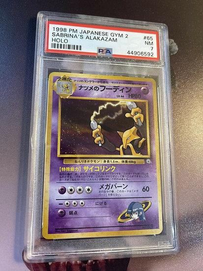 1998 PM JAPANESE GYM 2 #65 SABRINA'S ALAKAZAM HOLO - PSA 7 NM Pokemon