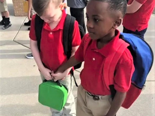 Photo of 8-year-old Wichita boy helping classmate with autism goes viral