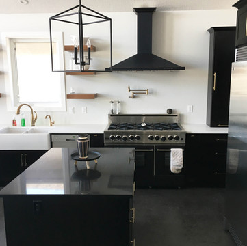 Crawford Homes built this stunning home. We were in awe of the beautiful kitchen this family designed.  Viatera Equinox for the 2 islands | Caesarstone Pure White for the surround.