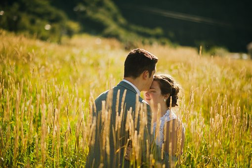 Newly wed couple in a wildflower meadow