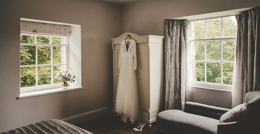 Bridal suite with wedding dress hanging up