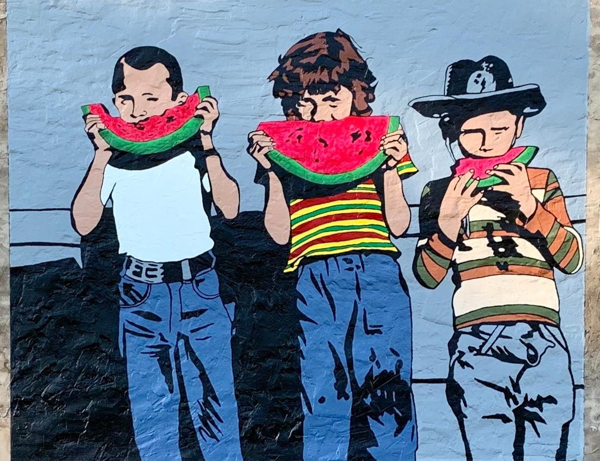 kids enjoying local grown watermelon