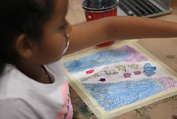 child making a cartoon watercolour painting