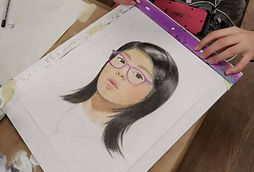 colour pencil self portrait drawing of young female student