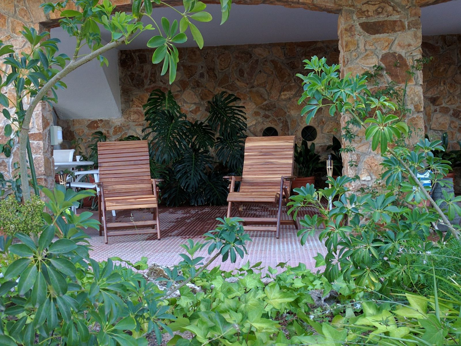 Teka chairs in a garden.jpg