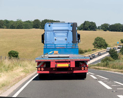 depositphotos_224469178-stock-photo-flatbed-lorry-seen-rear-a303