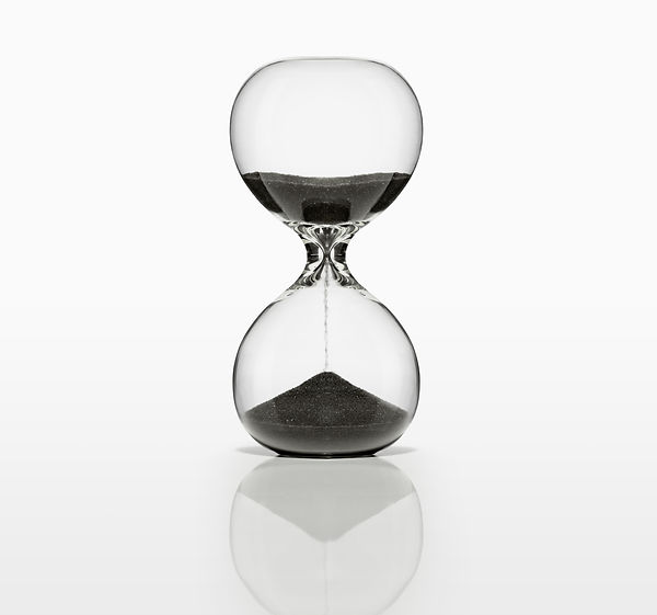 Sand Timer with black sand on white. Wit
