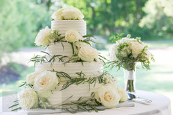 decorated cake and toss bouquet