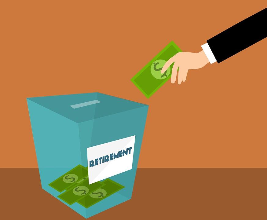 hand putting money in retirement bank
