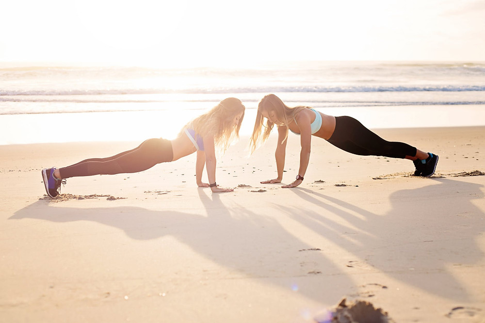 Resilience and Inner Strength, girls plank on beach powerful