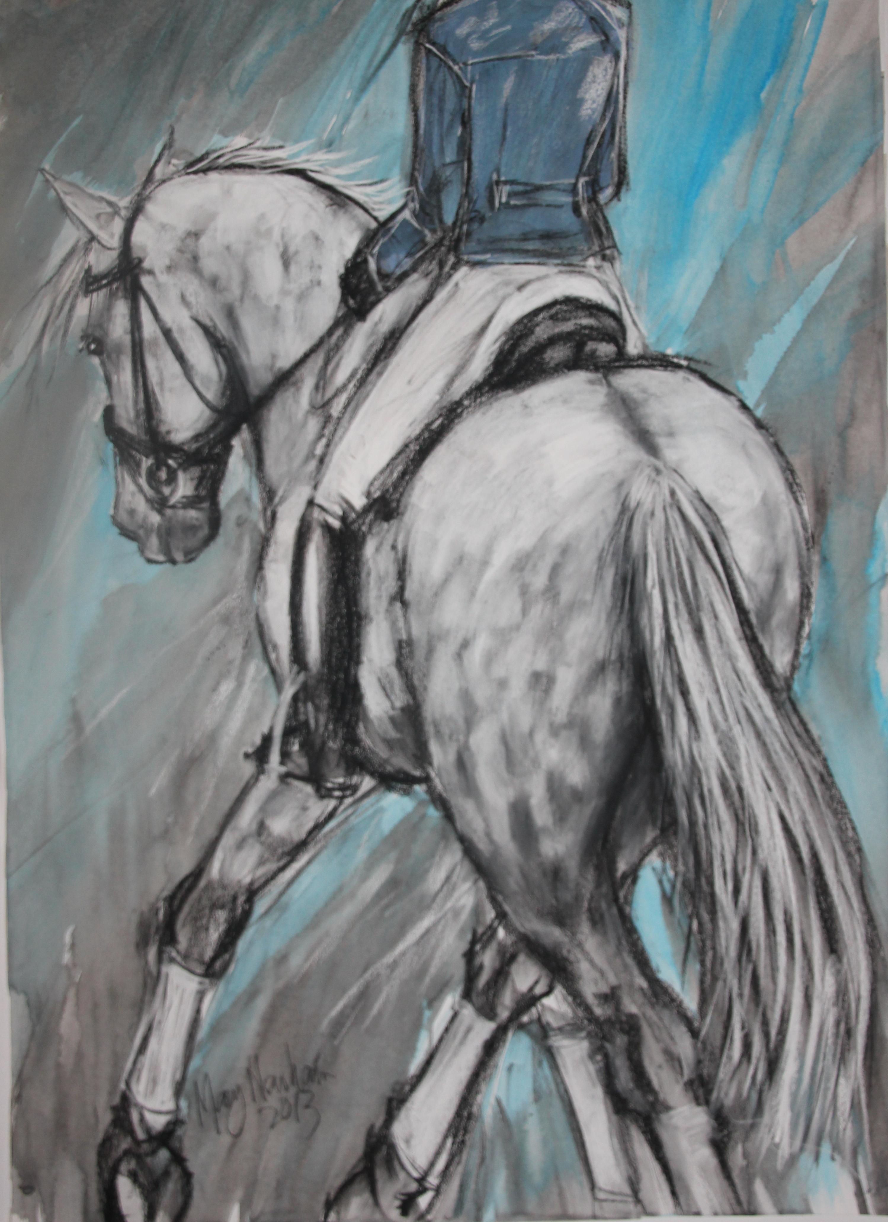 Grey horse in half pass