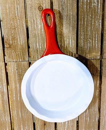 Red and white stoneware dish