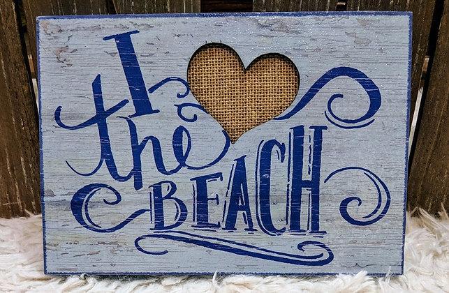 I love the beach wood sign