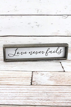 3 x 12.25 inch Love Never Fails Framed Wood Wall Sign