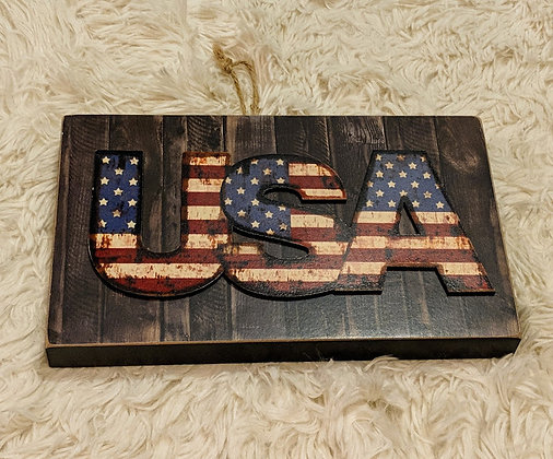 USA red, white, and blue wooden sign