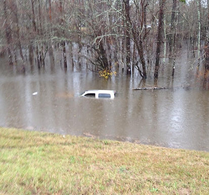 VEHICLE INTO FLOOD WATERS ON I-59