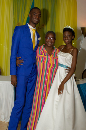 Noreen Daley with the Nelsons after hosting their wedding reception
