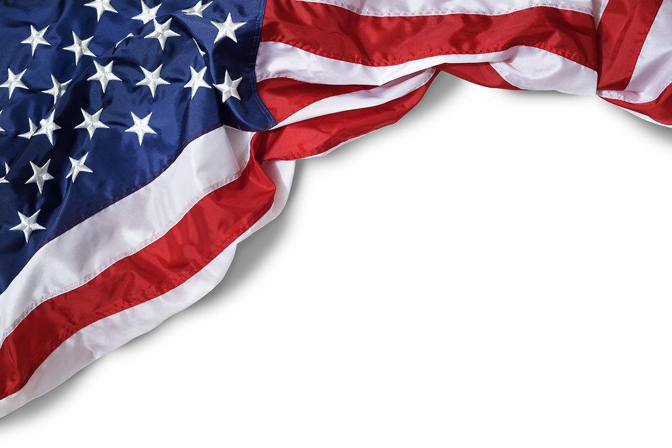 Closeup ruffled American flag isolated on white background.jpg