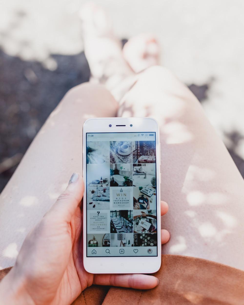 instagram in cellphone hand