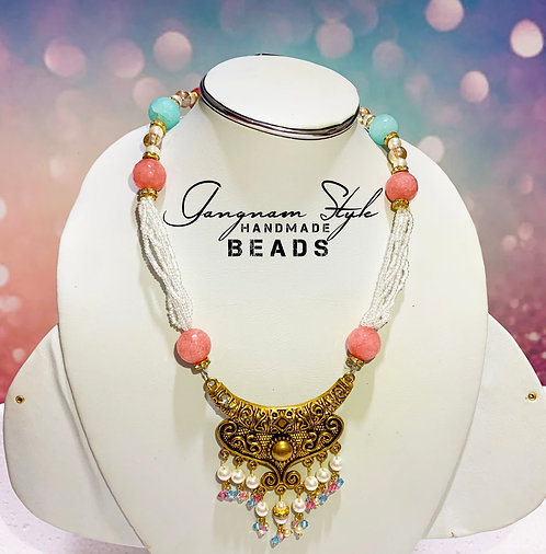 Stylish necklace with golden locket and crystal beads
