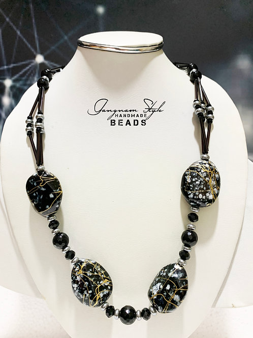 an unique necklace rock and black crystal beads