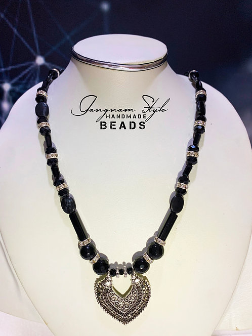 Stylish necklace antic with crystal beads