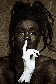 Black Man with white had Jahi Chikwendiu