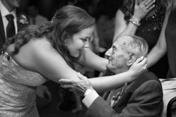 A bride and her grandfather share a special moment