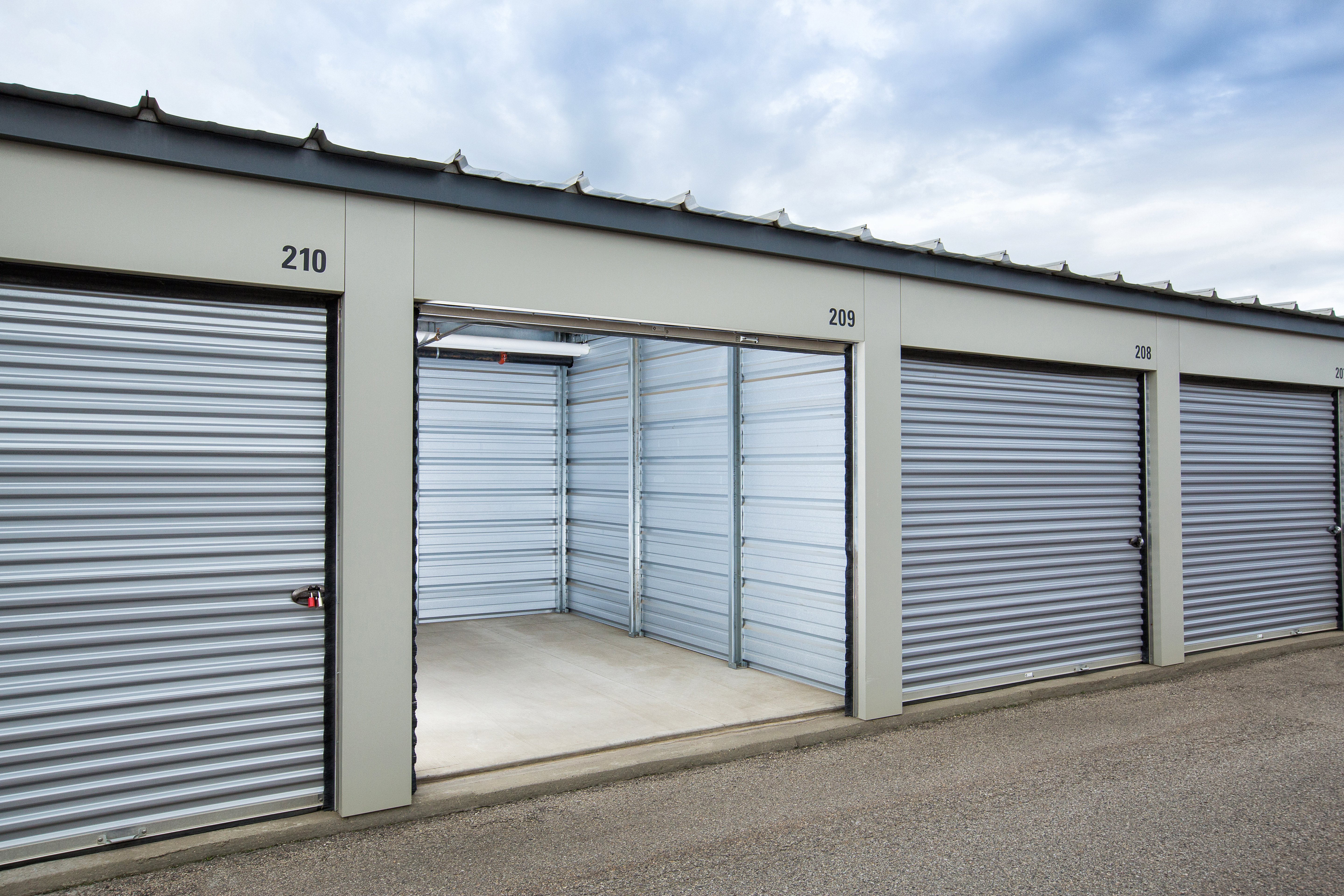 Open bay doors showing interior of storage unit