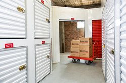 Interior of storage facility with a cart with boxes on it