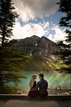 Couple overlooking Lake Louise, Alberta.