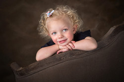 Smling young girl with curly blond hair