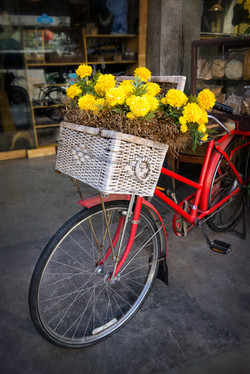 Red bike with yellow flowers in it's basket