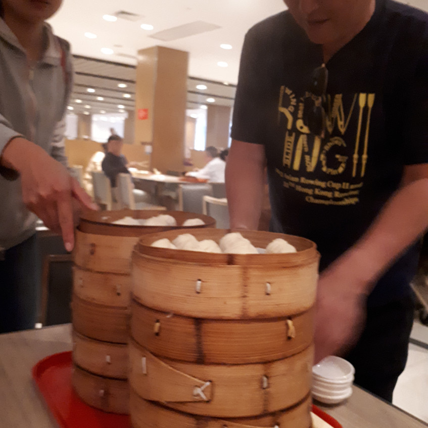 At our last lunch, rowers appeared out of nowhere to order and serve vast quantities of dumplings.